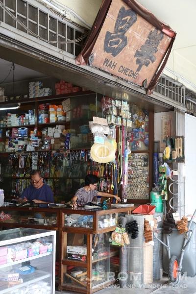 An old hardware shop and signboard along Jalan Petaling.
