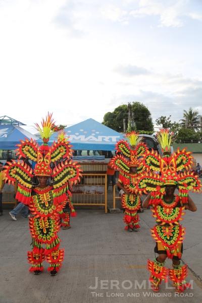 Welcoming the passengers at Kalibo - Mardi Gras style dancers.