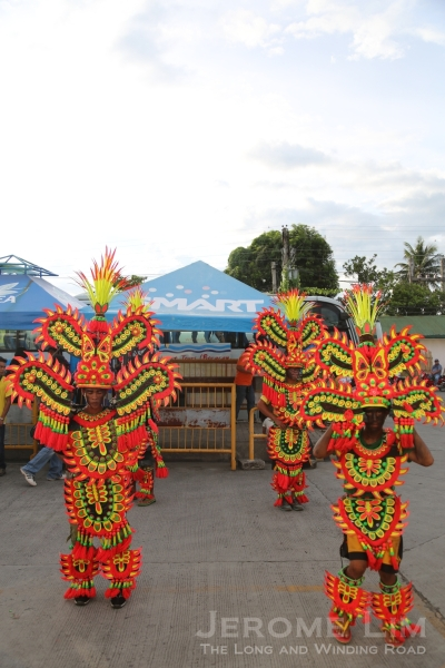 Welcoming the passengers at Kalibo - Mardi Gras style dancers.