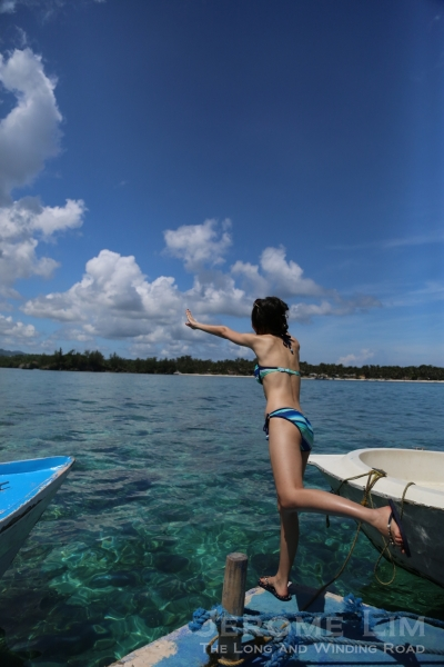 Christina jumping into the inviting crystal clear blue waters.