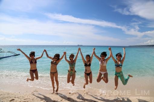 A huge jump for joy at Puka Beach.