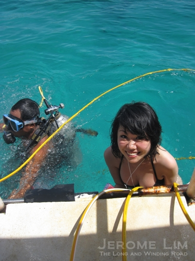 Just before the descent. A helmet will be placed over the person diving with a certified scuba diver on hand to lend assistance.
