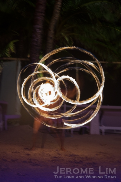 A fire dancer performing at Discovery Shores.