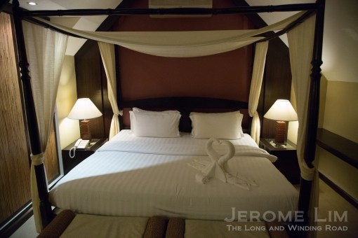 A King-sized canopy bed.