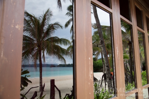 A reflection of the beach on the windows of the spa's rooms.