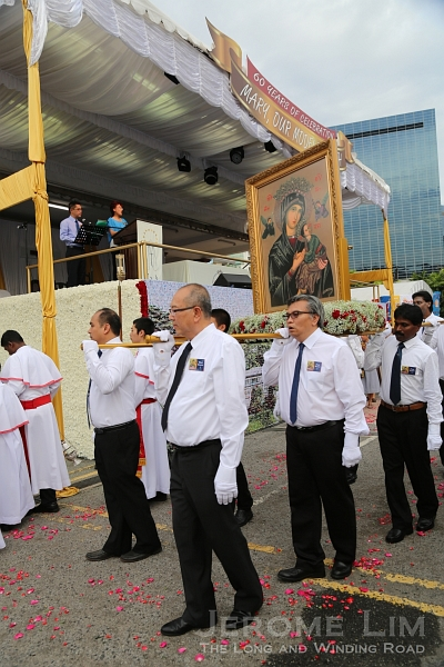 An image of Our Lady of Perpetual Help being carried during the procession.