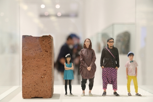 Figurines of Kinetic co-found Pann Lim and his family - the brick being s symbol of family unity.
