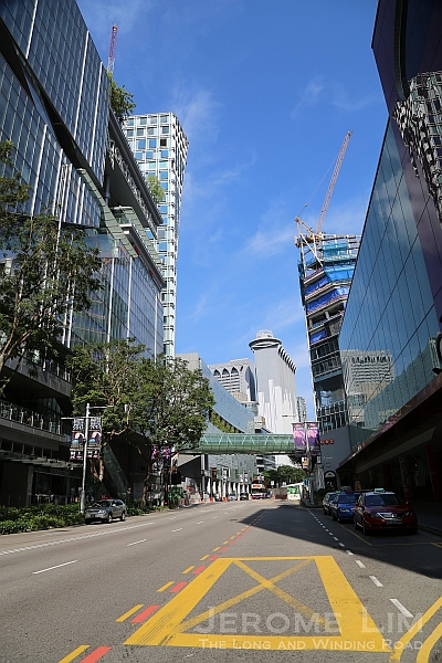 The stretch now sees many new retail developments such as Orchard Central on the left and under construction Orchard Gateway with its link bridge which will further alter the area's flavour.