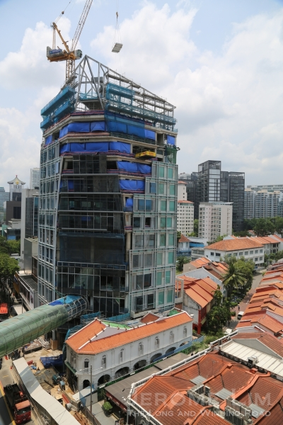 One side of Orchard Gateway with part of the link bridge. The conserved shophouse seen below it is fronting Orchard Road where a new Singapore Visitors' Centre will open.