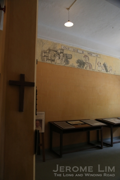 The unrestored upper portion of the fifth mural, St. Luke in Prison.