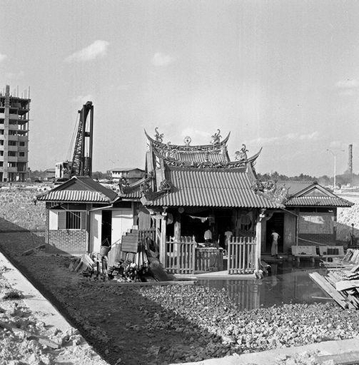 The temple finding itself in a hole in the ground as work on the new public housing estate of Toa Payoh was being carried out in 1968.