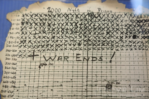 An exhibit - a card used by a POW to count the days of captivity.