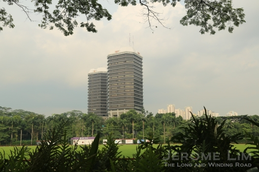 Thomson Road seen from across the Singapore Polo Club playing field.