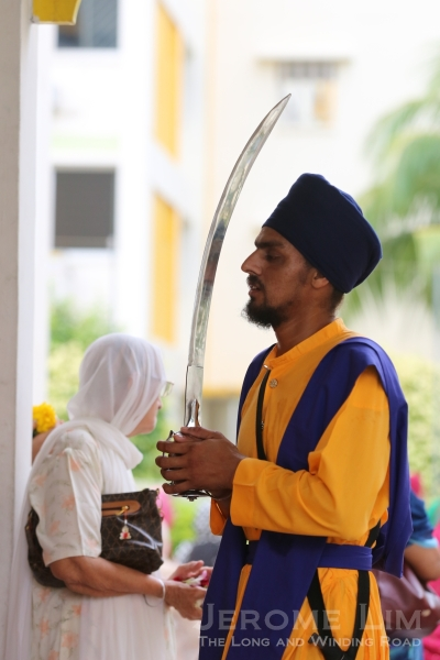 The commemoration of festivities at gudwaras or Sikh temples often sees the appearance of sword wielding armed guards who represent the Five Beloved Ones.