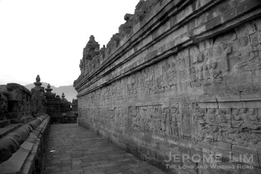 Reliefs lining a lower terrace,