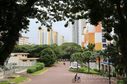 A window into a world I once knew. Ang Mo Kio was my third home to which I moved to in 1976. The area in the photograph is the car park in front of Block 217 which started life as a the first temporary bus terminal in Ang Mo Kio  from which I caught bus service number 166 to get to school.