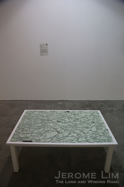 Thai artist Ruangsak Anuwatwimon's Hocus-Pocus - a table with shattered glass from Central World Plaza during the politically motivated violent protests of 2010.