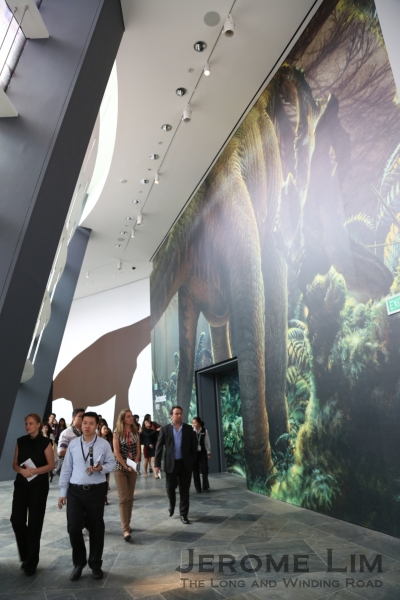 Visitors can appreciate the scale of the larger dinosaurs along the walkway to the entrance.