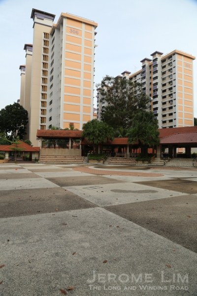 Block 306 (and 305 behind it), with a more recently added concrete plaza next to it.