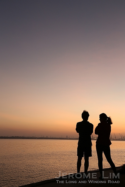 A couple watching the changing hues at sunrise, 6.56 am 31 Jan 2014.