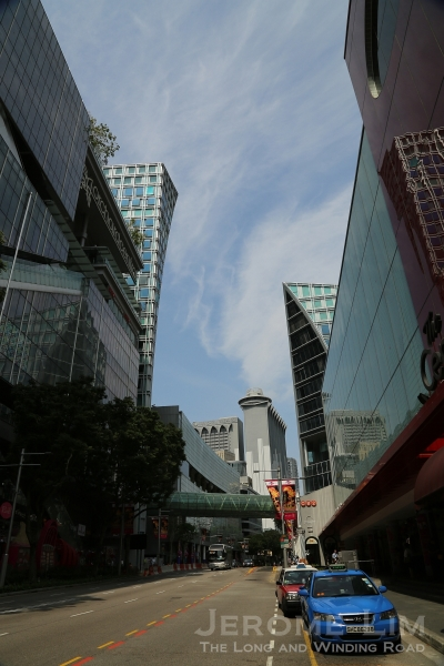 Orchard Road at ground level is dominated by the gleaming new edifices of glass and steel that has risen in the last two decades.