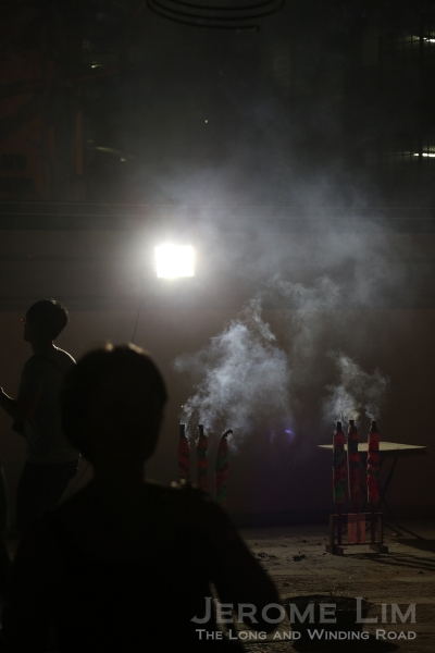 Smoke from large joss sticks in the compound.