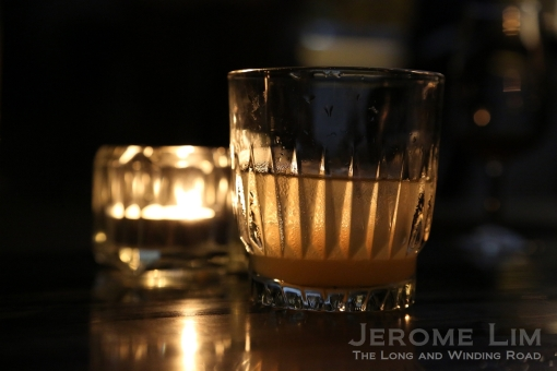 'Between the Sheets' - a light and refreshing combination of cognac and rum with orange liqeuer and lemon juice.