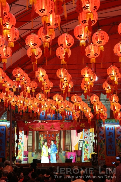The wayang stage under the glow of red lanterns at the Chai Chee United Temple.