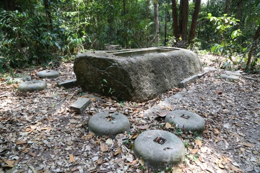 The site of the Syonan Jinja where remnants of what was once South-East Asia's  leading Japanese Shinto shrine is today an eerie yet peaceful spot. What is seen in the photograph is one of the more visible remnants, a sacred granite water trough for ritual purification.