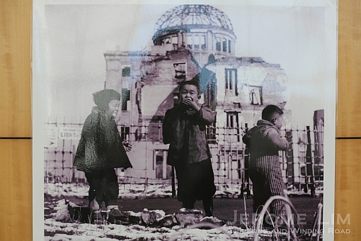An image of children quenching their thirst on snow that had covered the hypocentre in Hiroshima on display.
