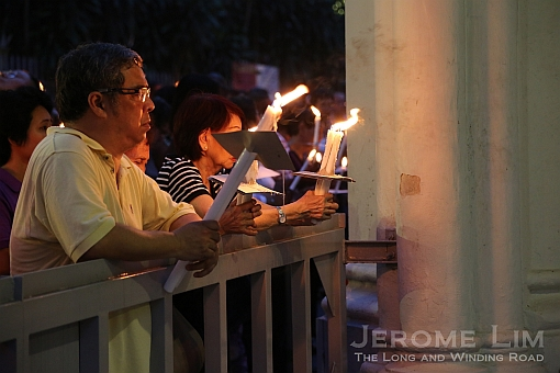 Participants in the procession fill the compound of the church in anticipation of the procession.
