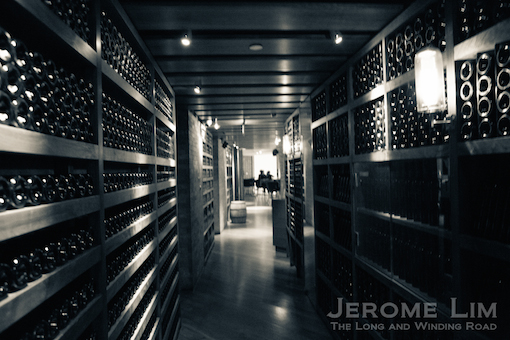 Wine racks are part of the bar's decor.