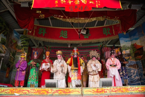 The opera troupe onstage paying respects to the deity.