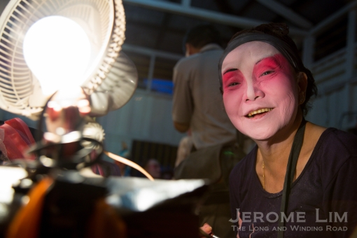 Backstage at the wayang stage: a festive face of Ubin.