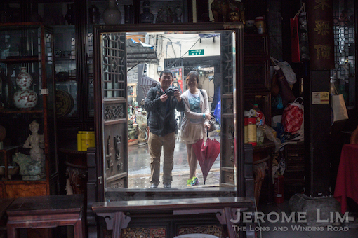 An antique reflected off an antique mirror in the sea of antiques at Dongtai Road Antiques Market.