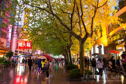 Shopping at the brightly lit and trendy Nanjing Road.