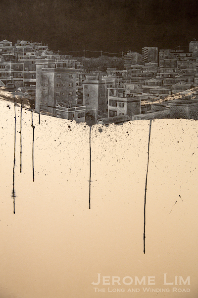 Detail of the cityscapes in acrylic that Park juxtaposes onto calligraphy like brushstrokes.