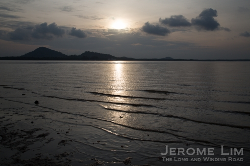 The incoming tide with a view of Pengerang on the left bank of Sungai Johor.