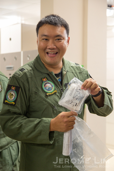 "The man they call ""Shrek"", CPT Chia, showing the bag the crew answer the call of nature into."