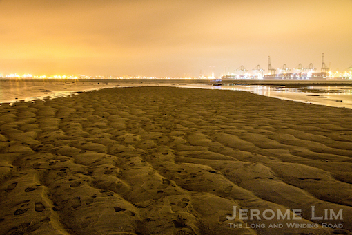 A view across the sandbar at the Cyrene Reefs towards the new container terminal at Pasir Panjang.