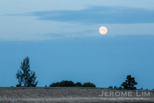 The super moon seen setting over Pulau Semakau.