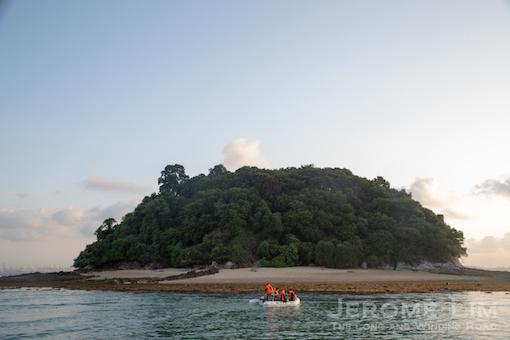 Heading on a dinghy towards the island.