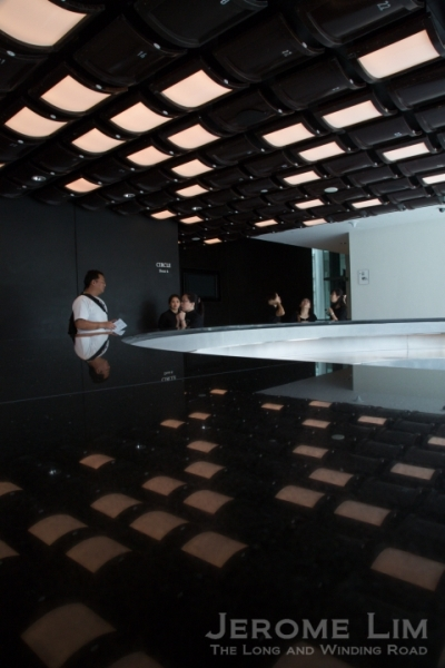 The 'Rubik's Cube' in the theatre's foyer and a reflection of it on a counter top.