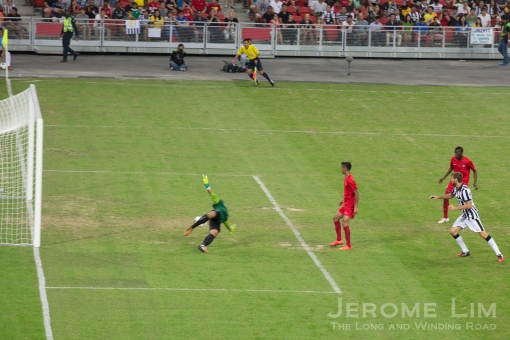 Despite the goalkeeper's acrobatics, the Singapore Selection let in five goals without reply.