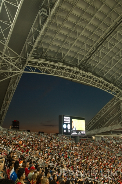 The impressive roof, a section of the crowd, and a view of the colours of the sunset.