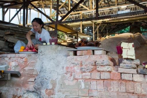 Preparing offerings to the kiln god.