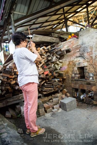 Offering a prayer to the kiln god.