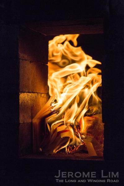 Flames seen through an opening in the firing box.