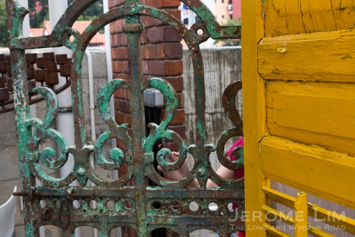 Reminders of the past: the old iron front gate and shuttered windows.
