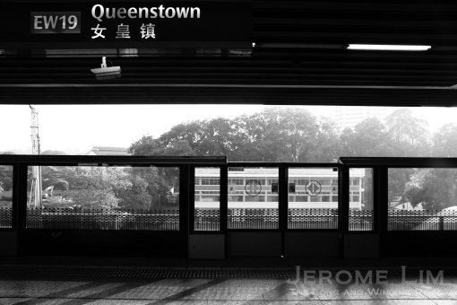 In passing - the soon to be demolished former Queenstown Driving Test Centre as seen through the platform doors of the Queenstown MRT Station.